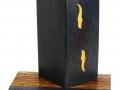 Reliure peau de serpent d'eau et essences de bois incrustées. Boite à chasses