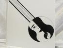 Livre d'or pour l'espace culturel « Chez Henri » à Marie-Galante : reliure plein box blanc et mosaïques de box noir